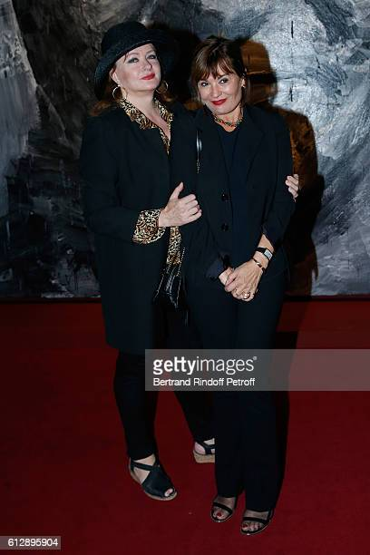 Actress Catherine Jacob and Exhibition's Curator Fabienne Bilal attend the Coluche Exhibition Opening This exhibition is organized for the 30 years...