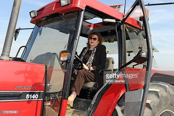 Actress Catherine Jacob poses in a tractor during the Champagne Nicolas Feuillatte Vendanges 2011 at Nicolas Feuillatte wine producing center on...