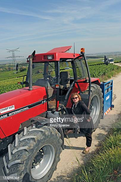 Actress Catherine Jacob poses with a tractor during the Champagne Nicolas Feuillatte Vendanges 2011 at Nicolas Feuillatte wine producing center on...