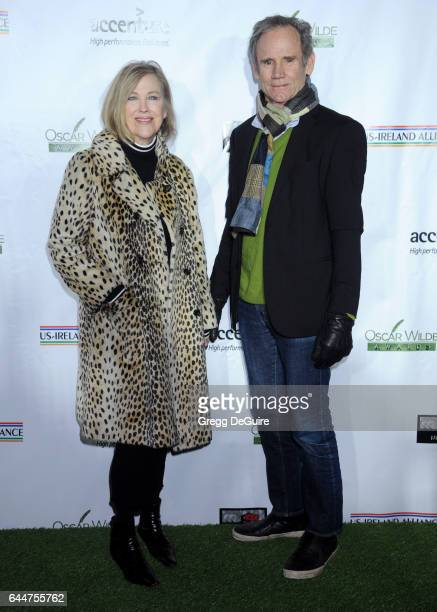 Actress Catherine O'Hara and Bo Welch arrive at the 12th Annual Oscar Wilde Awards at Bad Robot on February 23 2017 in Santa Monica California
