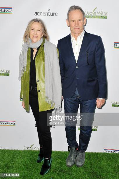 Actress Catherine O'Hara and Bo Welch arrive at the 13th Annual Oscar Wilde Awards on March 1 2018 in Santa Monica California