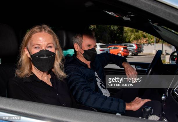 Actress Catherine O'Hara and her husband Bo Welch arrive at the Luxe hotel to pick up her gift bag at the drive-through gifting event organized by...