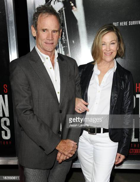 Actress Catherine O'Hara and husband Bo Welch attend the premiere of Captain Phillips at the Academy of Motion Picture Arts and Sciences on September...