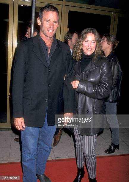Actress Catherine O'Hara and husband Bo Welch attend the Zero Effect Westwood Premiere on January 12 1998 at Mann National Theatre in Westwood...