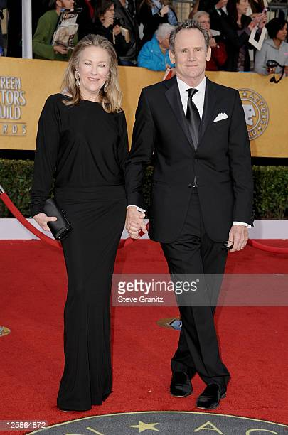 Actress Catherine O'Hara and husband director Bo Welch arrive at the 17th Annual Screen Actors Guild Awards held at The Shrine Auditorium on January...