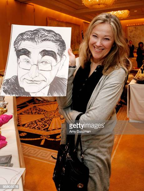 Actress Catherine O'Hara holding a sketch of Eugene Levy by artist Charles Johnston at the Oh Canada Gift Suite at Peninsula Hotel on January 15 2010...