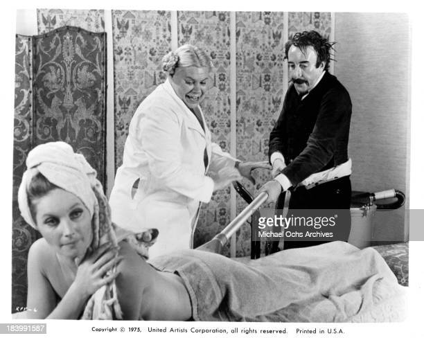Actress Catherine Schell and actor Peter Sellers on set of the United Artists movie The Return of the Pink Panther in 1975
