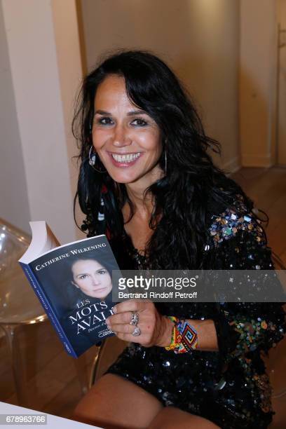 Actress Catherine Wilkening signs her book Les mots avales and exhibits her works at Galerie Vivienne on May 4 2017 in Paris France