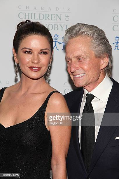 Actress Catherine ZetaJones and actor Michael Douglas attend the 2011 Children of Chernobyl's Children at Heart gala at the Chelsea Piers on November...