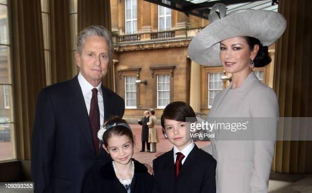 Actress Catherine Zeta-Jones arrives with her husband, actor Michael Douglas and their children Dylan and Carys Douglas, to attend a Royal...