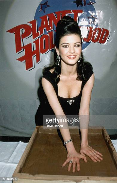 Actress Catherine ZetaJones sets her hands in cement after the premiere of 'Splitting Heirs' at Planet Hollywood on April 01 1993 in London