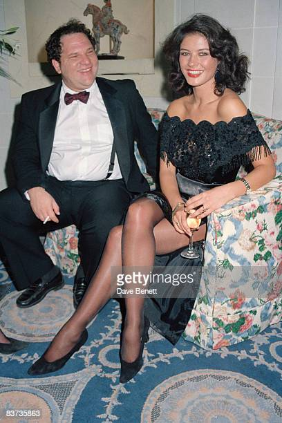 Actress Catherine ZetaJones with producer Harvey Weinstein at a party at the Hyde Park Hotel for the UK release of 'Hot Shots' 10th November 1991