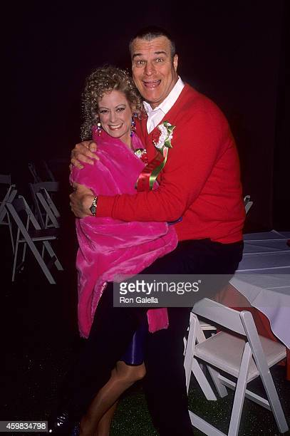 Actress Cathy McAuley and actor Richard Moll attend the 60th Annual Hollywood Christmas Parade on December 1 1991 at the KTLA Studios in Hollywood...