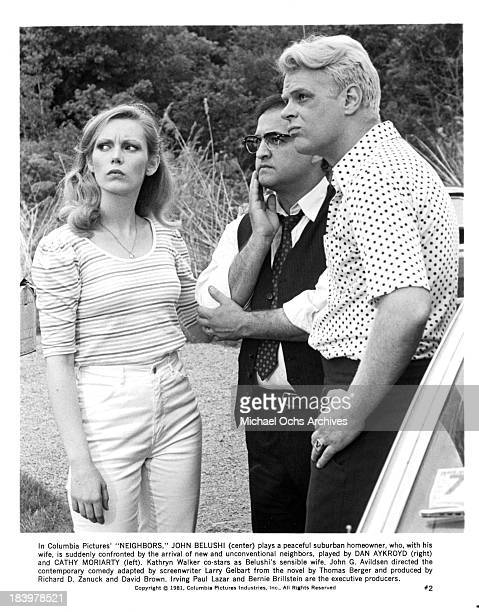 Actress Cathy Moriarty actor John Belushi and actor Dan Aykroyd on set of the Columbia Pictures movie Neighbors in 1981