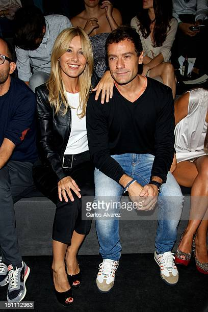 Actress Cayetana Guillen Cuervo and husband attends a fashion show during the Mercedes Benz Madrid Fashion Week Spring/Summer 2013 at Ifema on...