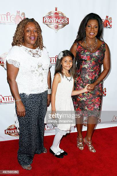 Actress CCH Pounder actress Lorraine Toussaint and her daughter Samara Grace attend the premiere of Annie at the Hollywood Pantages Theatre on...