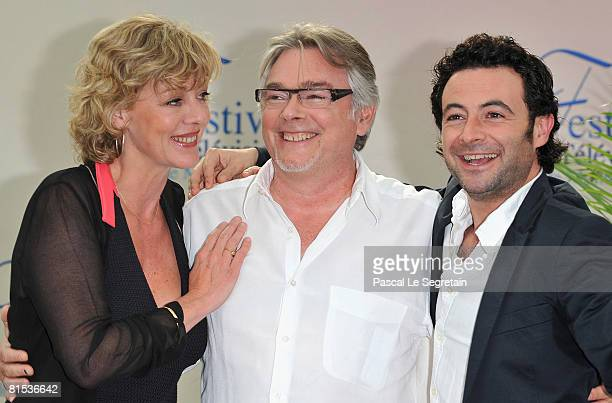 Actress Cecile Auclert and actors Christian Rauth and Sebastien Knafo attend a photocall promoting the television series Pere Maire on the fifth day...
