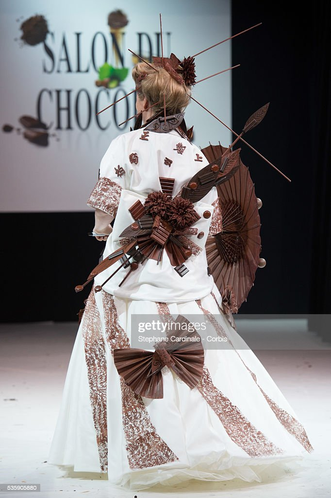 Actress Cecile Bois walks the runway and wears a chocolate dress made by designer Jean Doucet and 'Le Chocolat de H', during the Fashion Chocolate Show at Salon du Chocolat at Porte de Versailles, in Paris.