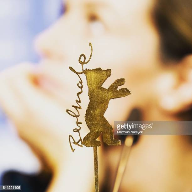 Actress Cecile de France is seen behind the Berlinale logo at the 'Django' press conference during the 67th Berlinale International Film Festival...