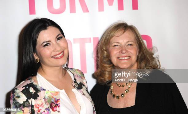 Actress Celeste Thorson poses with author Pamela L Newton at a luncheon in honor of Mother's Day for the release of Pamela L Newton's 'A Candle For...