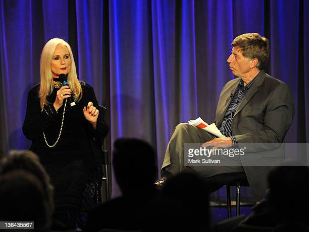 Actress Celeste Yarnall onstage with executive director of the GRAMMY Museum Robert Santelli during Elvis At The Movies at The GRAMMY Museum on...