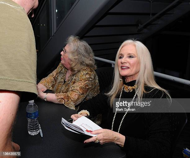 Actress Celeste Yarnall signs an autograph after Elvis At The Movies at The GRAMMY Museum on January 4 2012 in Los Angeles California