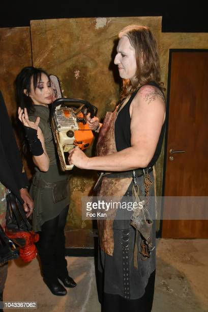 Actress Celine Tran exKatsuni and and a guest disguised in chainsaw slaughter Attend 'The End Apocalypse Party' at Hotel Kube on September 29 2018 in...