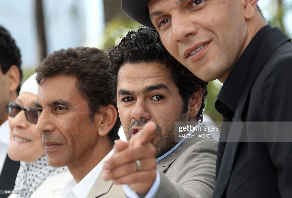 Actress Chafia Boudraa, French director Rachid Bouchareb, French actor Jamel Debbouze and French actor Roschdy Zem pose during the photocall of 'Hors La Loi' (Outside of the Law) presented in competition at the 63rd Cannes Film Festival on May 21, 2010 in Cannes.