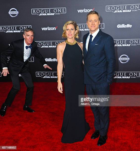 Actress Charissa Barton and actor Alan Tudyk about to be photo bombed by Bill Nye the Science Guy at the Premiere Of Walt Disney Pictures And...