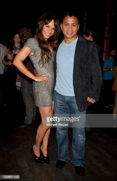 Actress Charity Shea and mixed martial artist Cung Le attend Smiley Los Angeles Premiere at AMC Universal City Walk on October 9 2012 in Universal...