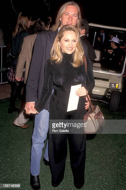 Actress Charlene Tilton and date Robert McGrane attend the 'Happy Gilmore' Universal City Premiere on February 7 1996 at Cineplex Odeon Universal...