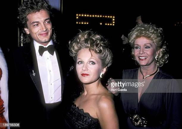 Actress Charlene Tilton and husband Domenick Allen and Actress Debbie Reynolds attend the 30th Annual Thalians Ball on October 12 1985 at Century...