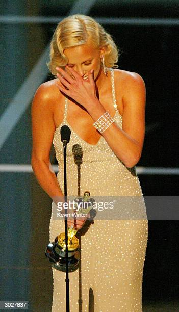 Actress Charlize Theron accepting the award for Best Performance by and Actress in a Leading Role for 'Monster' on stage during the 76th Annual...