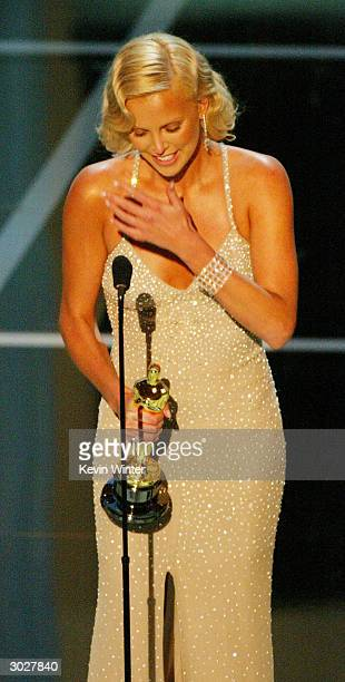 Actress Charlize Theron accepting the award for Best Performance by and Actress in a Leading Role for Monster on stage during the 76th Annual Academy...