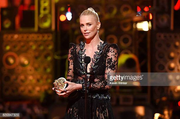 Actress Charlize Theron accepts Best Female Performance for 'Mad Max Fury Road' onstage during the 2016 MTV Movie Awards at Warner Bros Studios on...