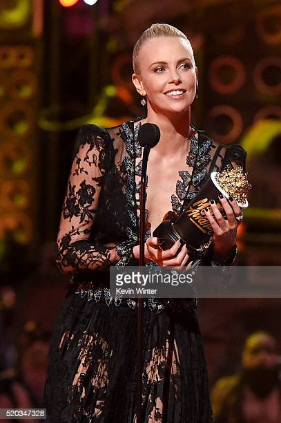 Actress Charlize Theron accepts Best Female Performance for 'Mad Max: Fury Road' onstage during the 2016 MTV Movie Awards at Warner Bros. Studios on...