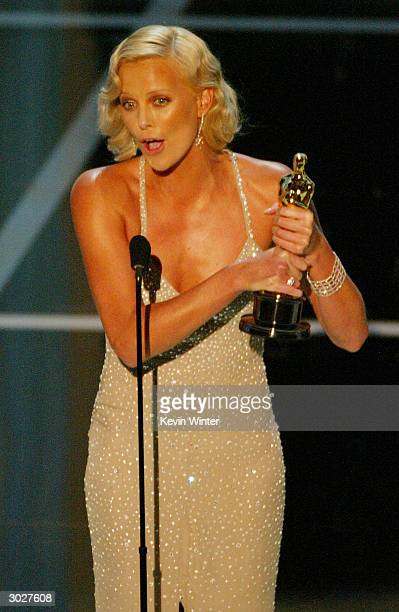 Actress Charlize Theron accepts her award for Best Performance by an Actress in a Leading Role for 'Monster' on stage during the 76th Annual Academy...