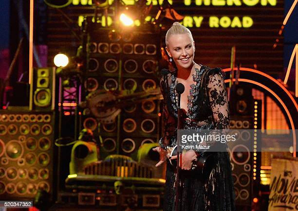 Actress Charlize Theron accepts the Best Female Performance award for 'Mad Max: Fury Road' onstage during the 2016 MTV Movie Awards at Warner Bros....