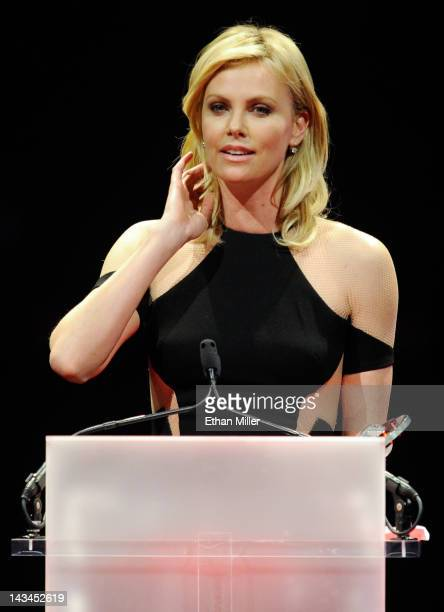 Actress Charlize Theron accepts the Distinguished Decade of Achievement in Film Award at the CinemaCon awards ceremony at The Colosseum at Caesars...