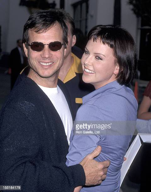 Actress Charlize Theron and actor Bill Paxton attend the 'American Pie' Universal City Premiere on July 7 1999 at Cineplex Odeon Universal City...