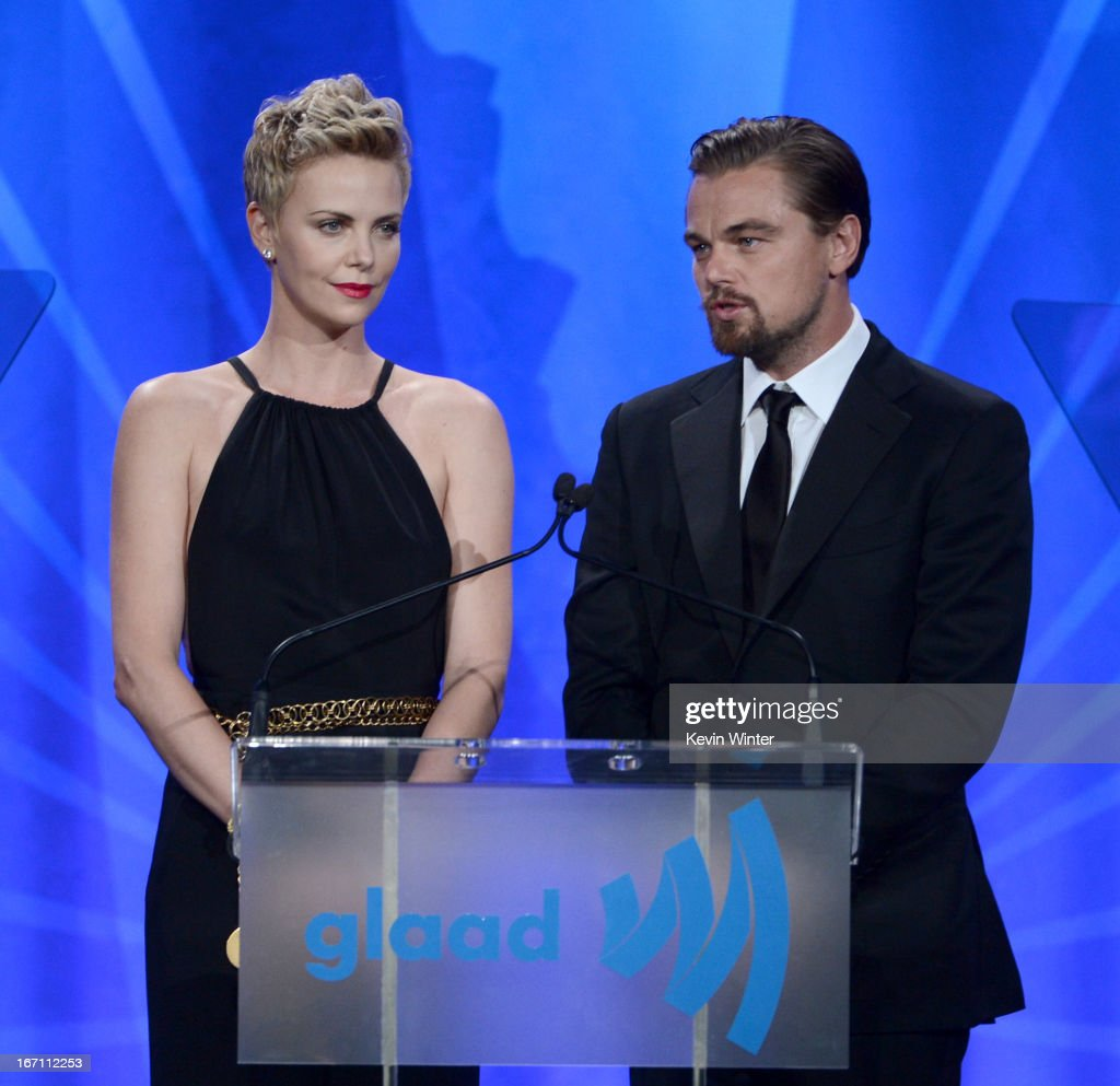 Actress Charlize Theron (L) and actor Leonardo DiCaprio speak onstage during the 24th Annual GLAAD Media Awards at JW Marriott Los Angeles at L.A. LIVE on April 20, 2013 in Los Angeles, California.