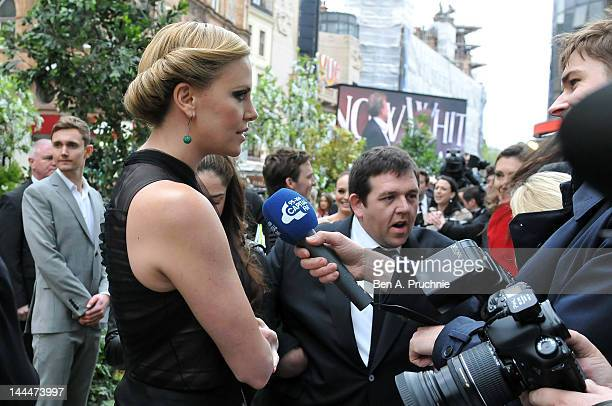 Actress Charlize Theron and actor Nick Frost are interviewed as they attend the World Premiere of 'Snow White And The Huntsman' at The Empire and...