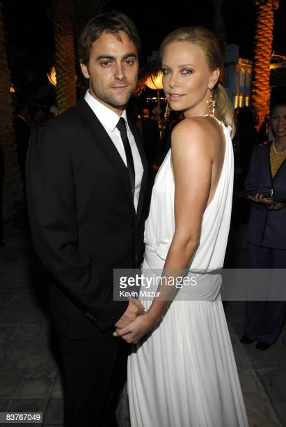 Actress Charlize Theron and actor Stuart Townsend attends the landmark Grand Opening of Atlantis The Palm Resort and the Palm Jumeirah on November 20...