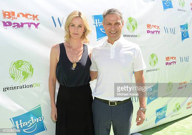 Actress Charlize Theron and coCEO of William Morris Endeavor Ari Emanuel attend the Points of Light generationOn Block Party on April 18 2015 in Los...