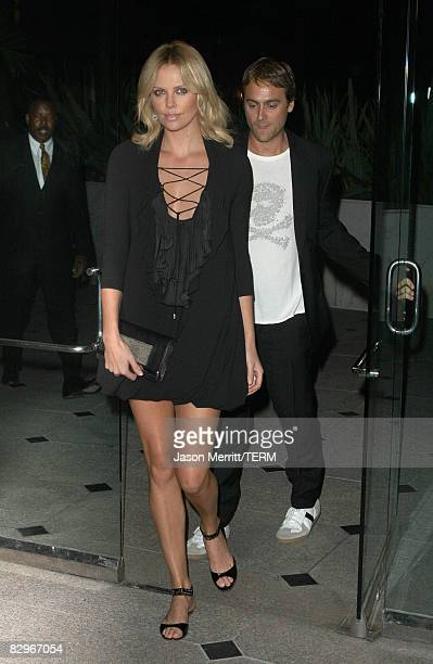 Actress Charlize Theron and Director Stuart Townsend arrives to the Redwood Palms Pictures and Genart premiere of Battle in Seattle on September 22...