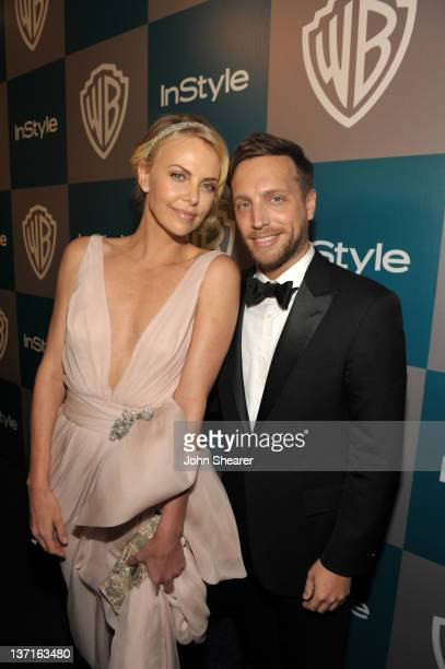 Actress Charlize Theron and Editor of InStyle Ariel Foxman attend the InStyle and Warner Bros 69th Annual Golden Globe Awards PostParty at The...
