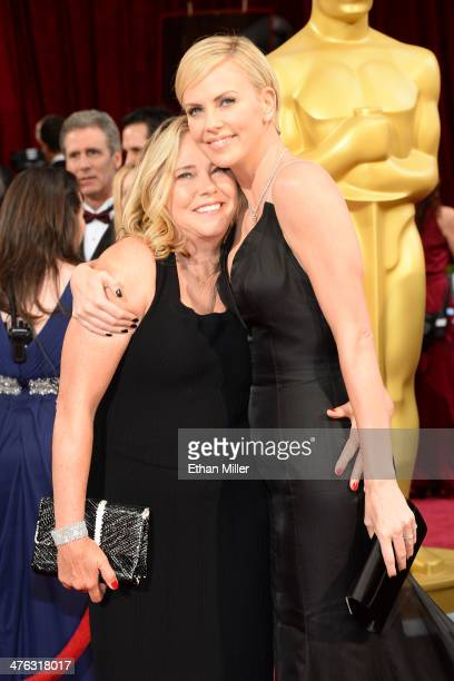 Actress Charlize Theron and Gerda Jacoba Aletta Maritz attend the Oscars held at Hollywood Highland Center on March 2 2014 in Hollywood California