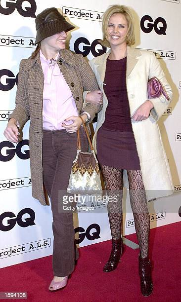 Actress Charlize Theron and her friend Ivana Malichovich arrive at the GQ Magazine Second Annual Hollywood Issue party February 15 2001 in West...