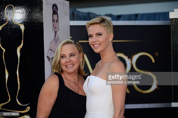 Actress Charlize Theron and her mother arrive on the red carpet for the 85th Annual Academy Awards on February 24 2013 in Hollywood California AFP...