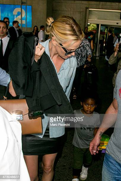 Actress Charlize Theron and her son Jackson arrive at the Nice airport ahead the 68th annual Cannes Film Festival on May 12 2015 in Cannes France